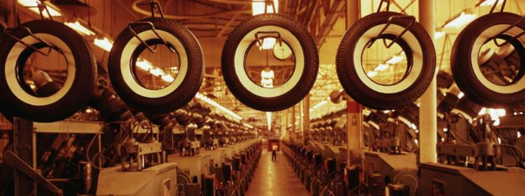 New tires travel like so many hangman's nooses past a bank of recently installed automated curing presses at a tire factory in 1960. (Charles Rotkin / Corbis)
