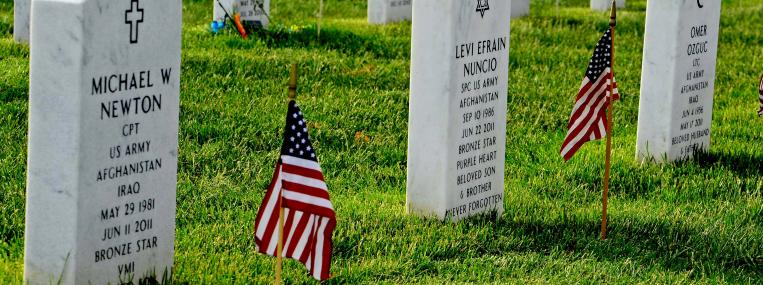 Photo of Arlington Cemetary gravestones via U.S. Department of Defense