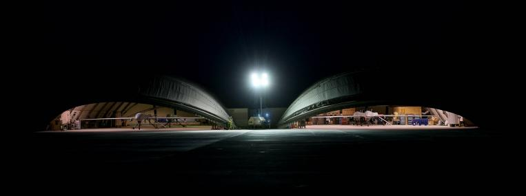 Two Predator drones rest in hangars at a base in Kandahar, Afghanistan. Even after the United States withdraws its last combat troops from Afghanistan next year, it will continue to operate drones in the country. (Getty Images)