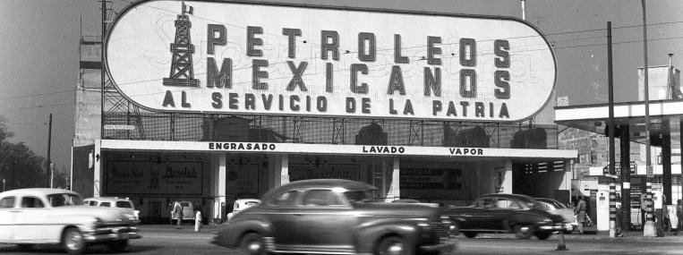 "Petroleum and patriotism have long proved a heady mix in Mexican politics. ""Serving the nation,"" says this 1956 Pemex sign. (Getty Images)"