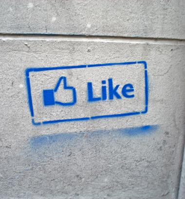 "A Facebook ""Like"" icon spray-painted onto a wall. (sofiabudapest / Flickr)"