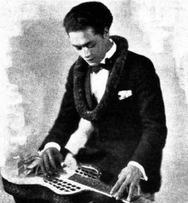 Photo of Hawaiian steel guitarist Sam Ku West via Wikimedia Commons
