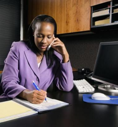 Photo of young woman working in an office by Passive Income Dream.com via flickr