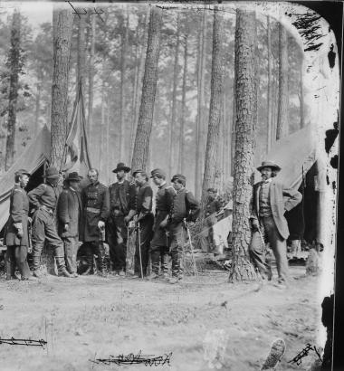 Mathew Brady appears leaning against a tree in this June 1864 photograph he took of Union General Robert B. Potter (hatless) and his staff. (Archives)