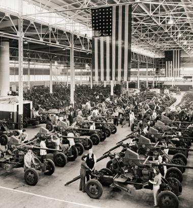 "During World War II, President Franklin D. Roosevelt's ""arsenal of democracy"" churned out more weapons than any other nation. In 1942, workers at a Firestone Tire and Rubber plant in Akron, Ohio, assembled antiaircraft guns. (Bettmann / Corbis)"