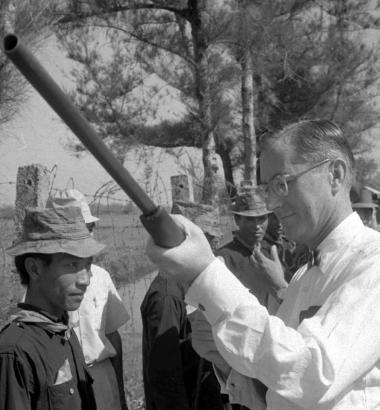 William Colby, then head of the U.S. pacification program in South Vietnam, inspects the shotgun of a rural villager in Thua Thien province in 1969. Photo by Hoorst Fass via AP Images.