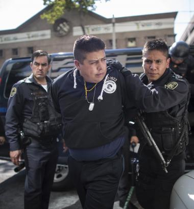 Arrests of police officers and other officials are a disconcertingly common sight in Mexico. This former federal police officer was arrested in Mexico City earlier this year and charged with leading a gang that committed robberies and kidnappings. (Getty Images)