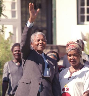 Photo: Nelson Mandela, with his then-wife Winnie, waves to a crowd in 1990 on the day after he was released from prison. He had been jailed for 27 years. In 1994 he was elected president of South Africa, a post he held for five years. WALTER DHALDHLA / AFP / GETTY IMAGES