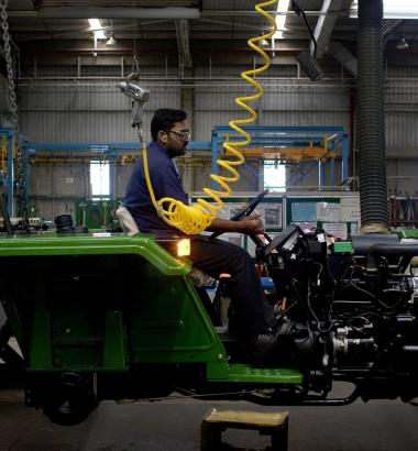 A John Deere factory in Pune, India, is a visible sign of the offshoring of jobs. But many middle-paying U.S. jobs have been replaced by better-paid managerial, professional, and technical positions. (Scott Eells / Redux)