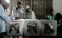 Photograph: In the notorious Port-au-Prince slum of Cité Soleil, voters cast their ballots in Haiti's 2006 national elections. CHARLES ECKERT / REDUX
