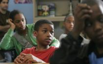 A seventh grader at Samuel J. Green Charter School in New Orleans looks on in class. After Hurricane Katrina in 2005, the city's school system was drastically restructured, with a new emphasis on charter schools geared toward college preparation. (Lee Celano / Reuters / Corbis)