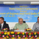 Narendra Modi, flanked by Ford executives and government officials, promoted development in Gujarat--and some say, Hindu fanaticism. (Ford Asia Pacific)